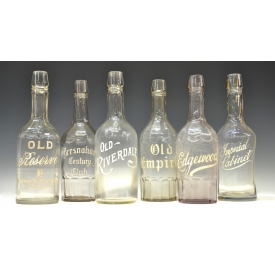 (6) ENAMELED LABEL GLASS BARBACK SALOON BOTTLES