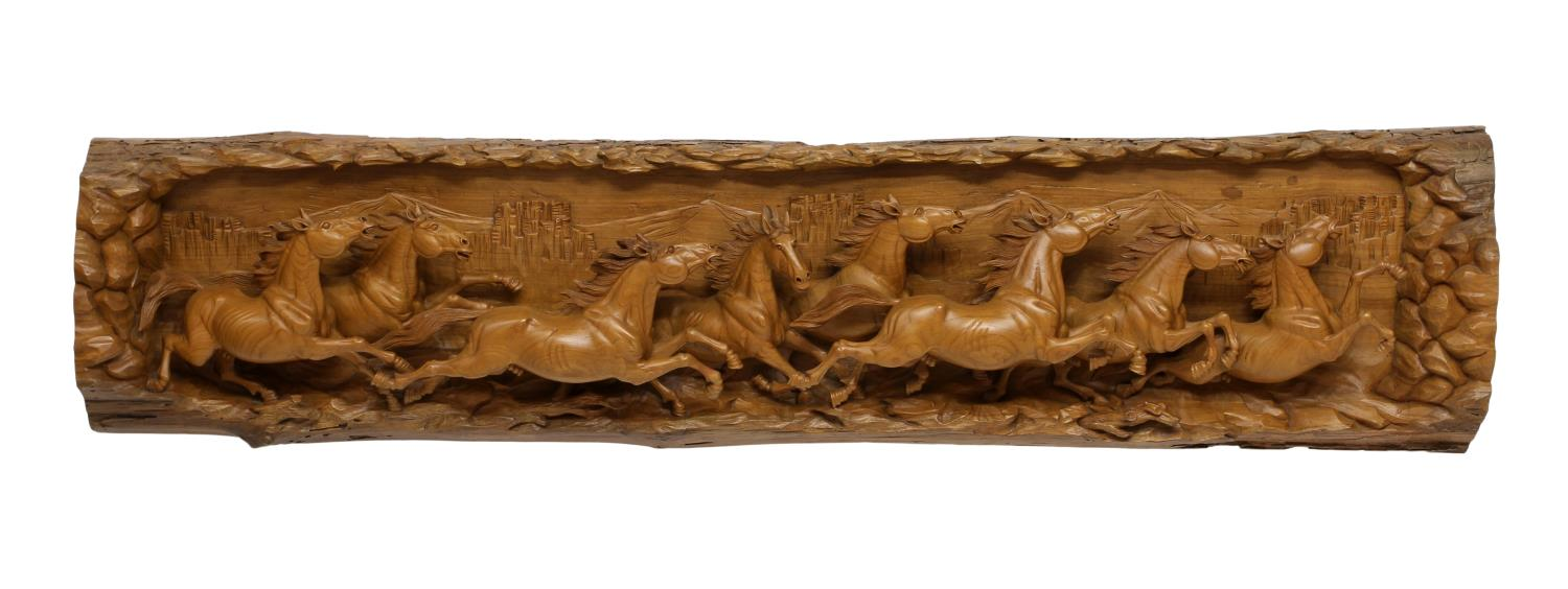 Relief carved tree trunk herd of wild horses august