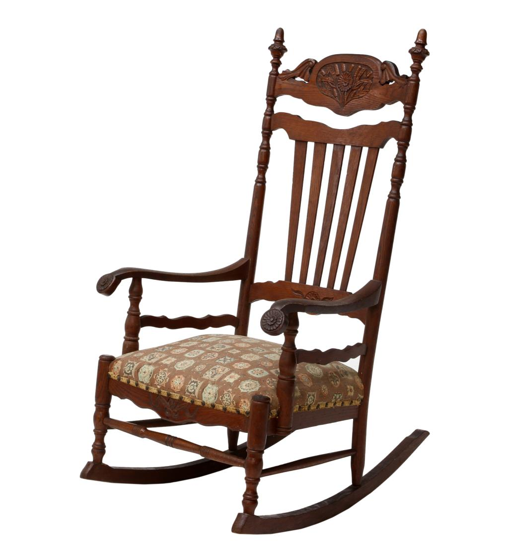ANTIQUE CARVED OAK ROCKING CHAIR