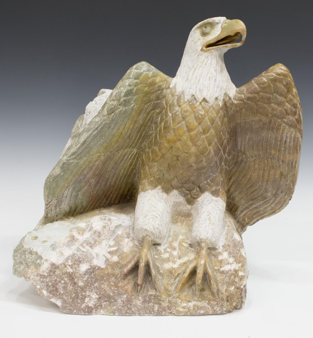 Stone bird carving and navajo ceramic